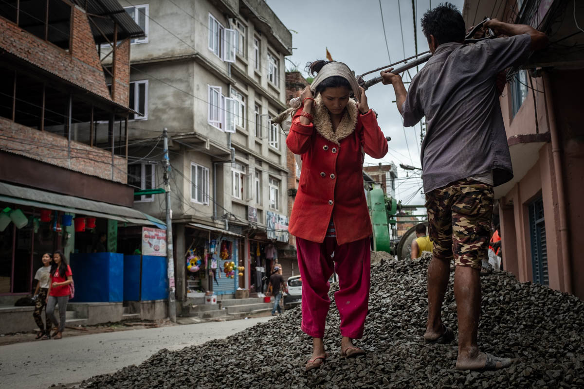 It is common in Nepal to see women, girls and children working in construction sites, brick manufacturing and in other heavy and dangerous occupations. [Violeta Santos Moura/Al Jazeera]