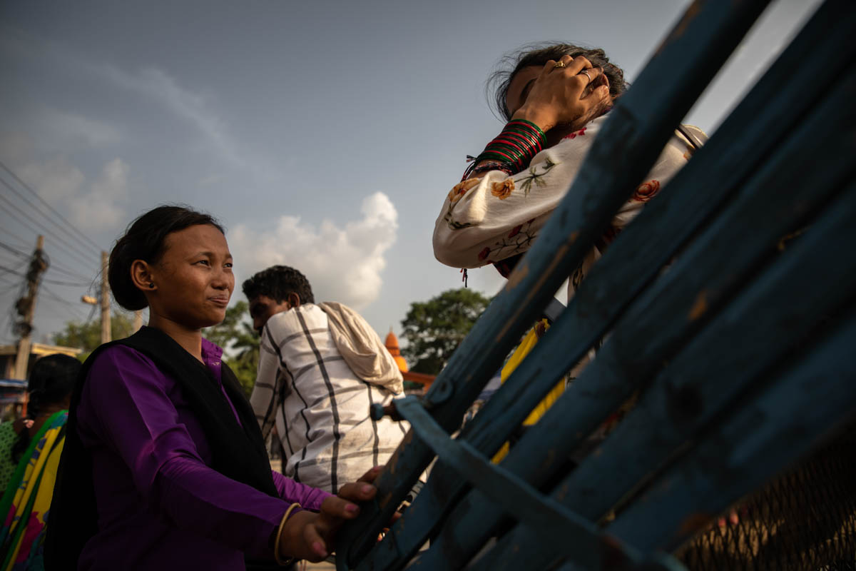 Danu Thapa, 24, an anti-trafficking NGO border monitor, stops a rickshaw carrying a girl to India through the city of Bhairahawa, to question her about the nature of her travel to determine whether she is safe or a victim of trafficking. One of the ways NGO monitors corroborate statements given by women and girls is to ask for relatives' phone numbers and call them to cross-check information. [Violeta Santos Moura/Al Jazeera]