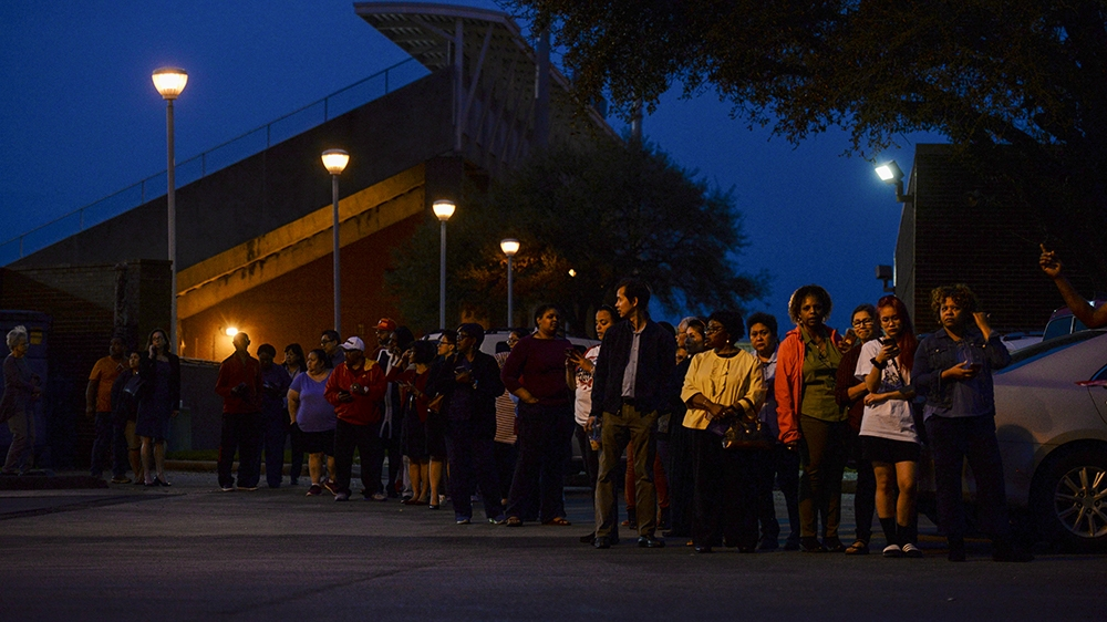 Voters wait in line to cast their ballot in the Democratic primary at a polling station in Houston, Texas, U.S. March 3, 2020.  REUTERS/Callaghan O'Hare