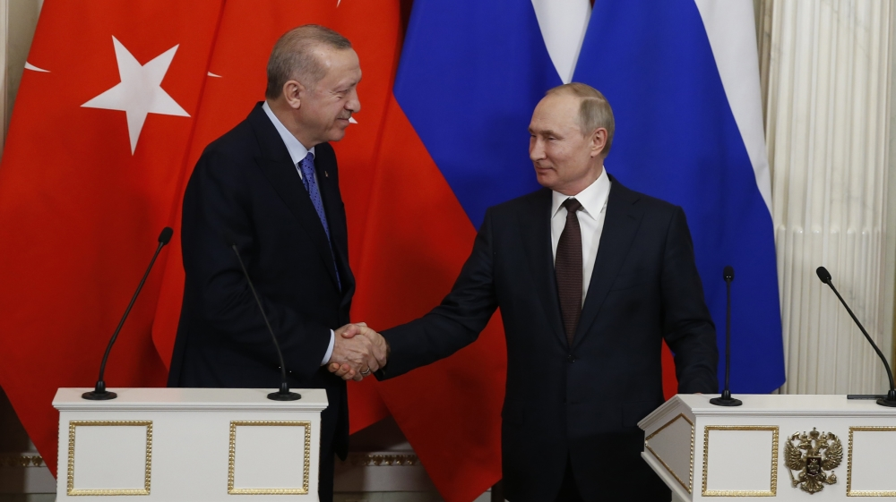 Putin News Conference- - MOSCOW, RUSSIA - MARCH 5: President of Turkey Recep Tayyip Erdogan (L) and President of Russia Vladimir Putin (R) shake hands after their joint news conference following their