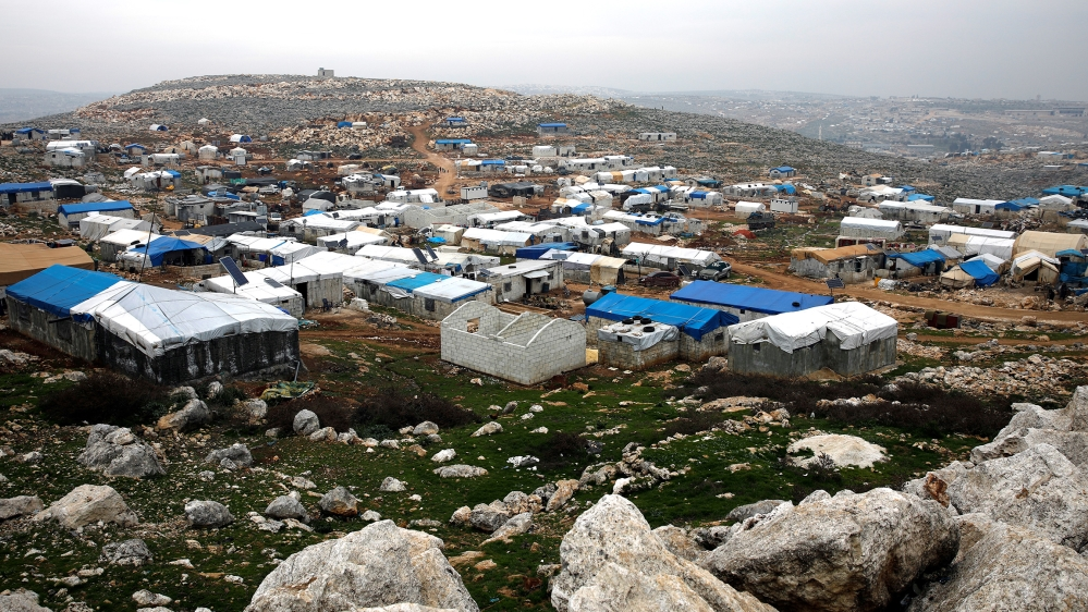 Makeshift shelters of internally displaced Syrians are seen from a hill top as part of an IDP camp located in Sarmada, Idlib province, Syria February 28, 2020. REUTERS/Umit Bektas