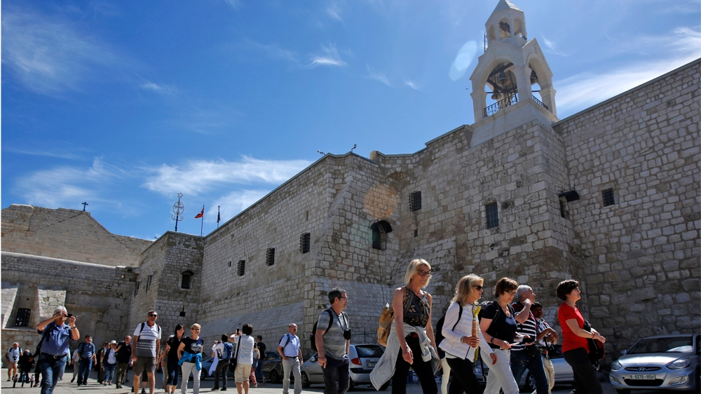 Foreign tourists visit the Church of the Nativity, revered as the birthplace of Jesus Christ, in the West Bank city of Bethlehem on March 05, 2020.