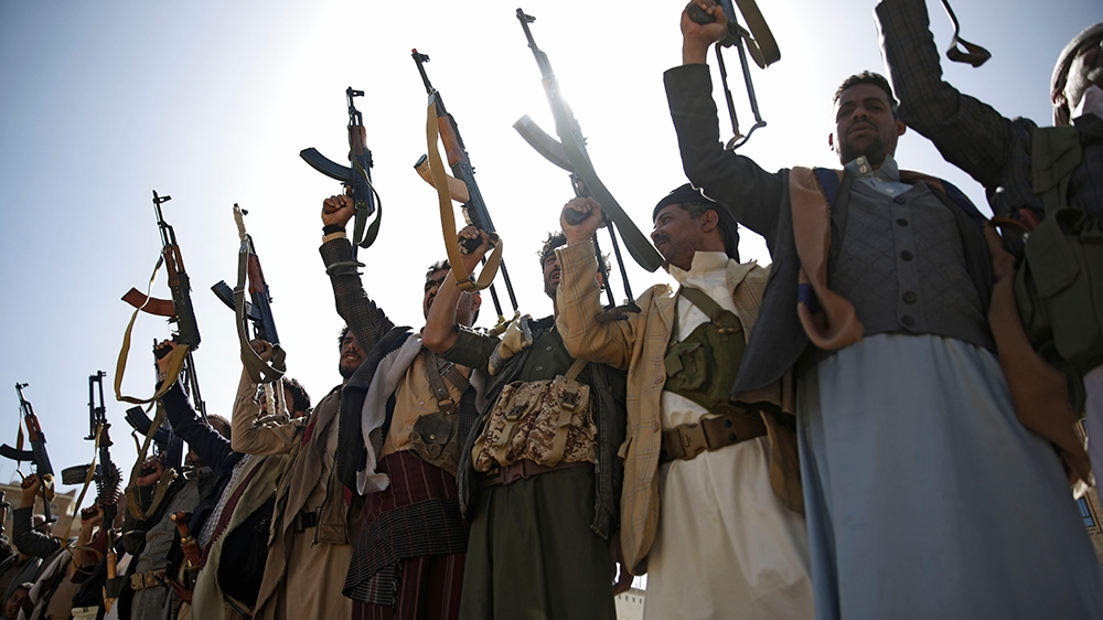 Houthi rebel fighters chant slogans as they hold their weapons during a gathering aimed at mobilizing more fighters for the Houthi movement, in Sanaa, Yemen, Thursday, Feb. 20, 2020. (AP Photo/Hani Mo