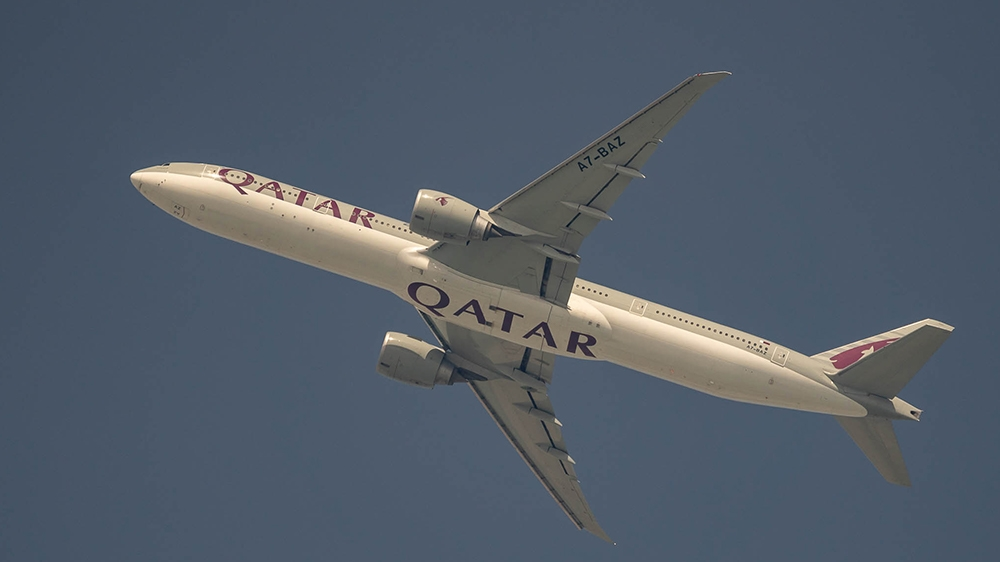 Qatar Airways Boeing 777 aircraft Flying from Doha to Kuwait on March 7, 2020 [Sorin Furcoi/Al Jazeera]