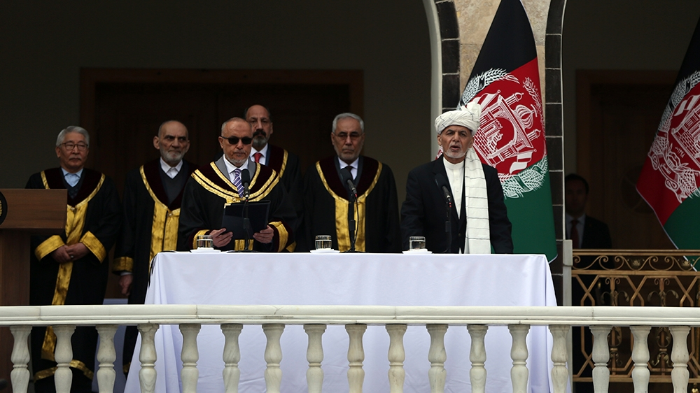 Afghan President Ashraf Ghani, right, is sworn in by Chief Justice Sayed Yousuf Halim, during his inauguration ceremony at the presidential palace in Kabul, Afghanistan, Monday, March 9, 2020. (AP Pho