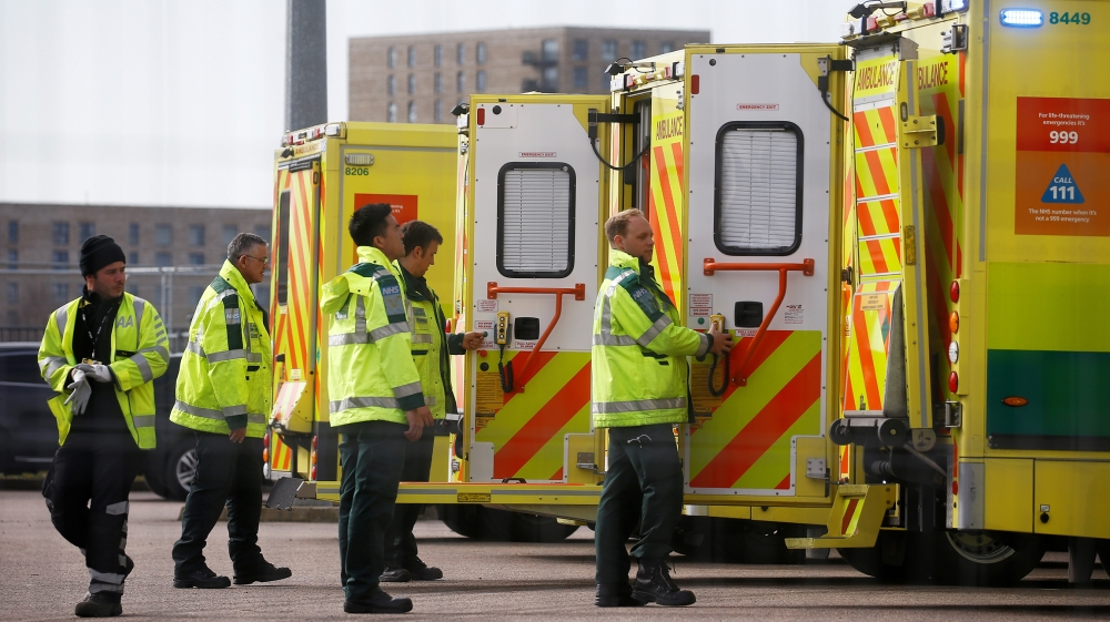 Paramedics and ambulances are seen outside the Excel Centre, London while it is being prepared to become the NHS Nightingale Hospital, as the spread of the coronavirus disease (COVID-19) continues, Lo