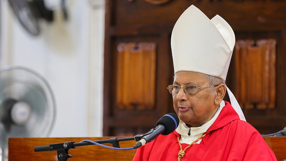 epa08355760 Archbishop of Colombo Cardinal Malcolm Ranjith holds an online Good Friday service at the almost deserted all Saints church†during an island-wide curfew,†in Colombo, Sri Lanka, 10 April 20