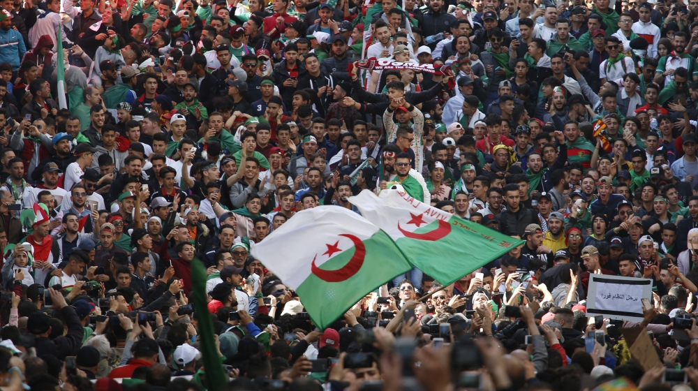 Demonstrators wave the Algerian flag as thousands gather for a rally in Algiers, Friday April 5, 2019, chanting, singing and cheering after their movement forced out longtime President Abdelaziz Boute