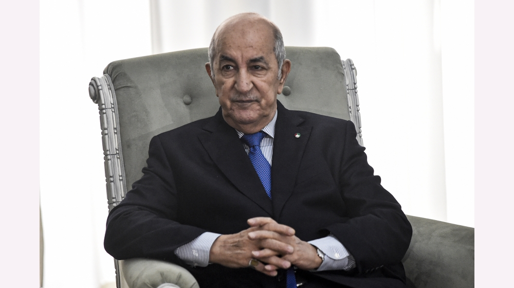 Algerian President Abdelmadjid Tebboune meets with the visiting French Foreign Minister (unseen) in the capital Algiers on January 21, 2020. Le Drian arrived to Algiers for a brief visit to discuss bi