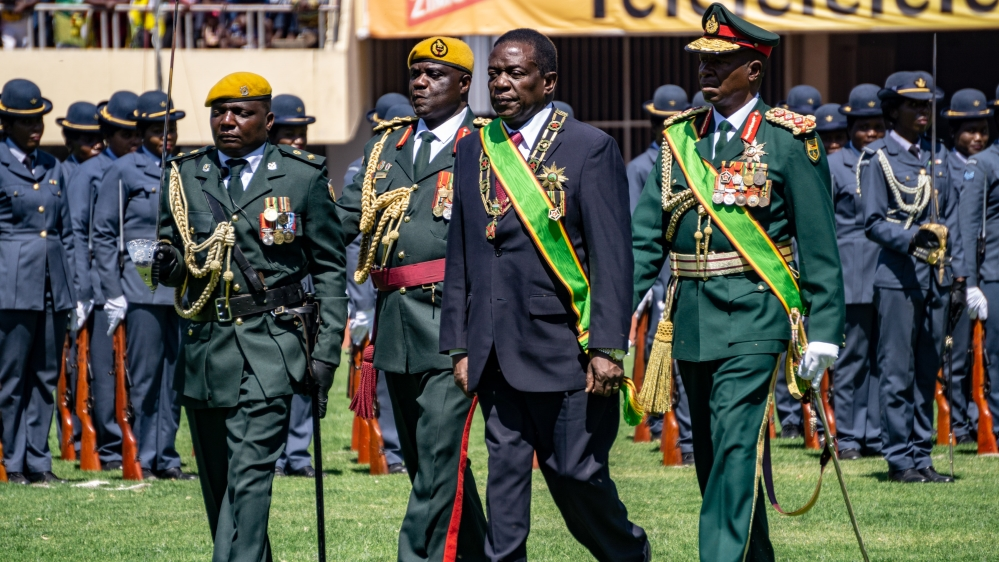 President Emmerson Mnangagwa inspects a police parade accompanied by the top members of the military during his inauguration after a disputed election victory in 2018.