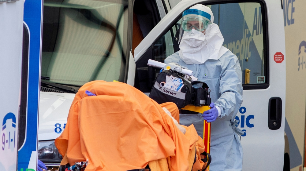 A paramedic transports a patient to Mount Sinai Hospital as the number of the coronavirus disease (COVID-19) cases continue to grow in Toronto, Ontario, Canada April 17, 2020. REUTERS/Carlos Osorio
