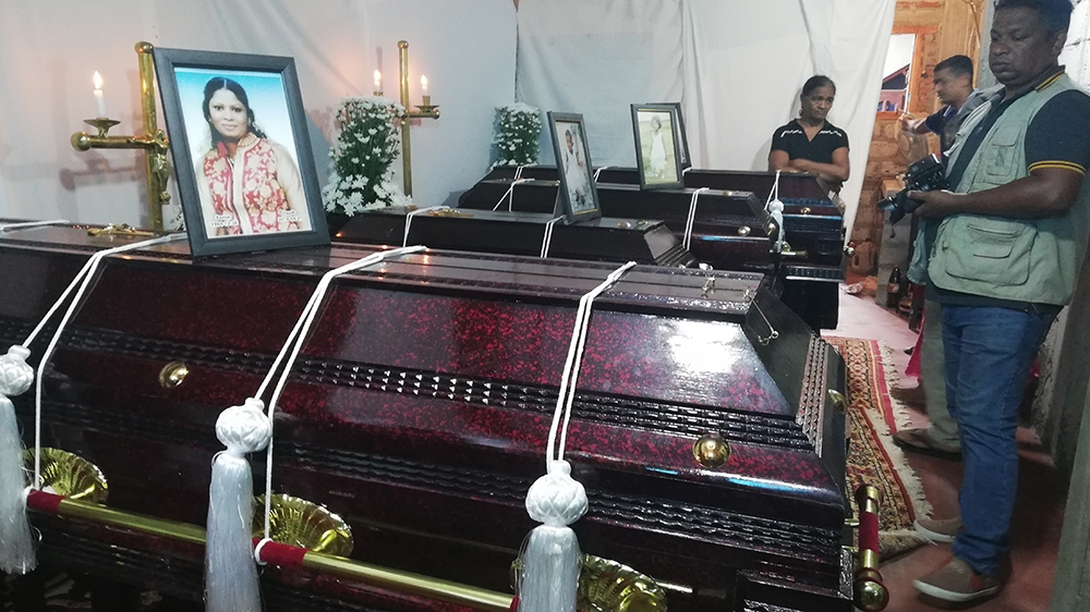 The coffins of the four family members  [Aanya Erinyes/Al Jazeera]