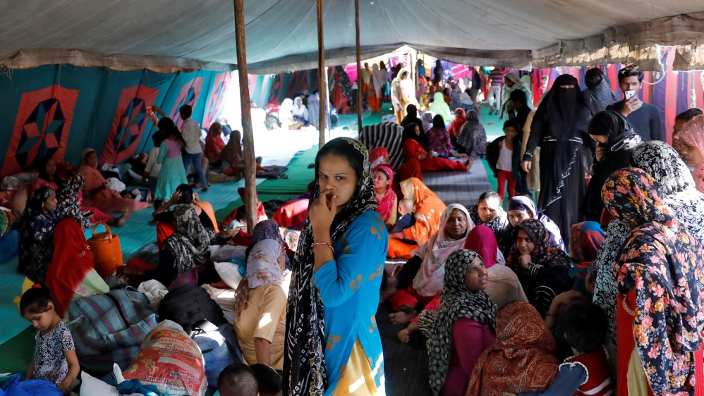 Muslims sit inside a relief camp in Mustafabad in the riot-affected northeast of New Delhi
