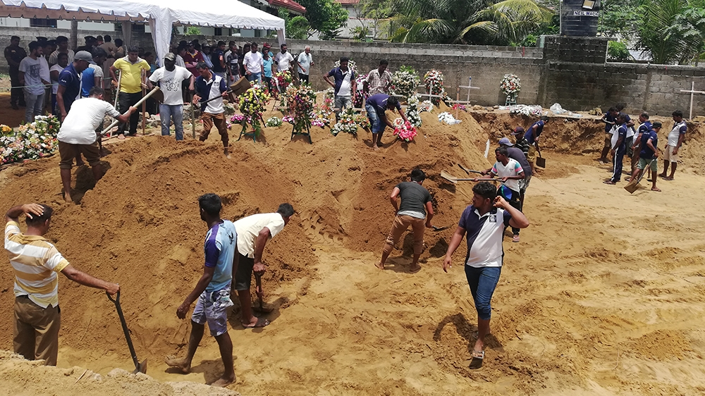 The mass grave in Negombo where victims of the St. Sebastian's Church bombing were laid to rest. [Aanya Erinyes/Al Jazeera]