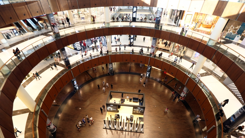 People shop at The Dubai Mall in Dubai