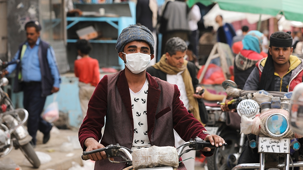 A man wears a protective face mask as he rides a motorcycle amid fears of the spread of the coronavirus disease (COVID-19) in Sanaa, Yemen March 16, 2020. Picture taken March 16, 2020. REUTERS/Khaled