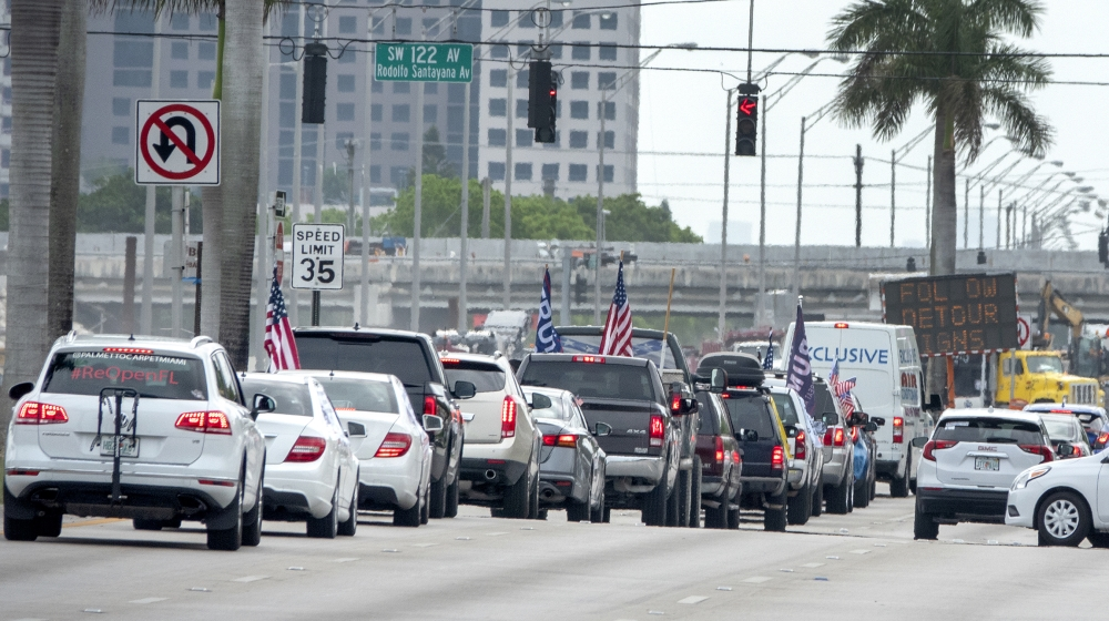 A group of protesters attend the 'Reopen Miami-Dade County' vehicle caravan, calling on state and local officials to reopen Florida's economy, in Miami, Florida, USA, 25 April 2020. The caravan was or