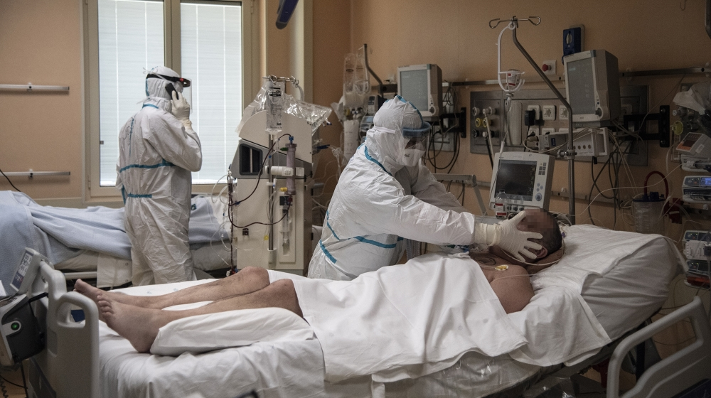 Doctors attend to patients in intensive care in the COVID-19 ward of the Maria Pia Hospital in Turin. The Piedmont region around the industrial city of Turin reported 854 COVID-19 related deaths. MARC