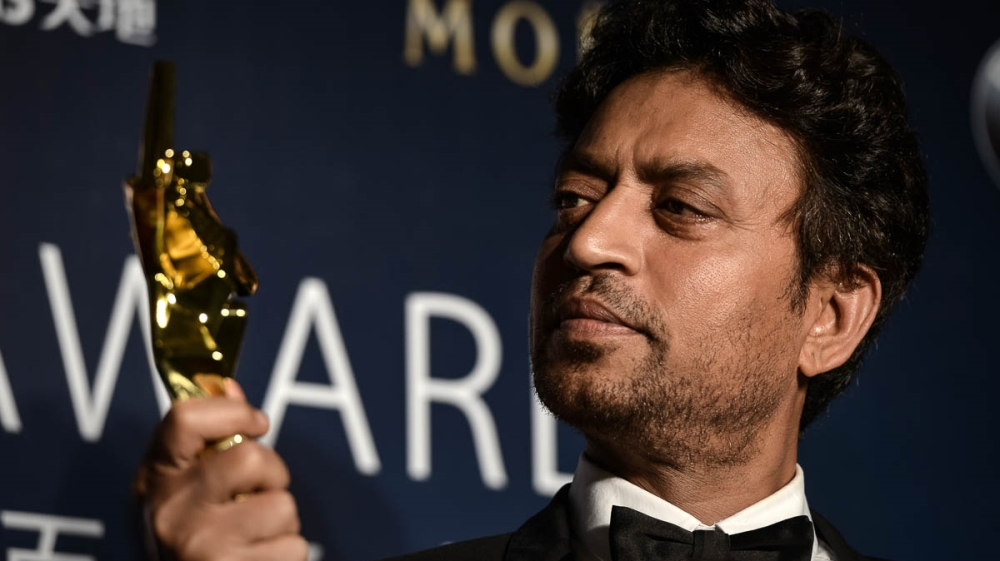 Best actor winner Irrfan Khan of India poses with his trophy during the Asian Film Awards in Macau on March 27, 2014. Movie stars attended the event held annually since 2007, aimed at showcasing the r