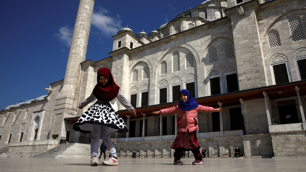 Children play in front of the locked Fatih Mosque as Turkey suspended mass prayers in mosques nationwide until the risk of coronavirus disease (COVID-19) passes in Istanbul