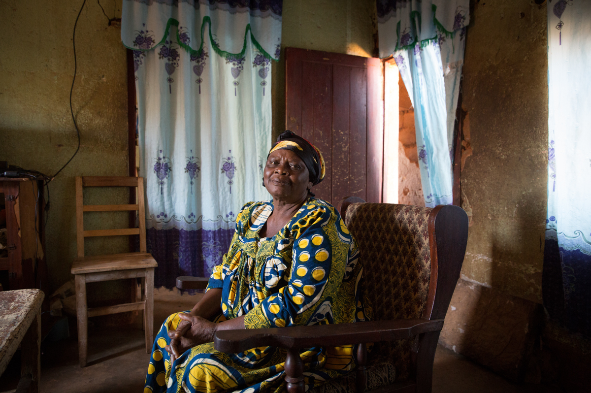 It was May 2018 when 71-year-old Celine escaped her village with her bedridden son, her frail mother, daughter and her three grandchildren. 'On the day we fled, there were heavy clashes and people ran into the bush to hide from the shooting. I could not run with them. My son is bedridden. My mother is nearly 100 years old. I had to stay behind. The army entered our house and asked me: 'Why are you still here?'. I showed them my son and my mother.' [Ingebjorg Karstad/NRC]