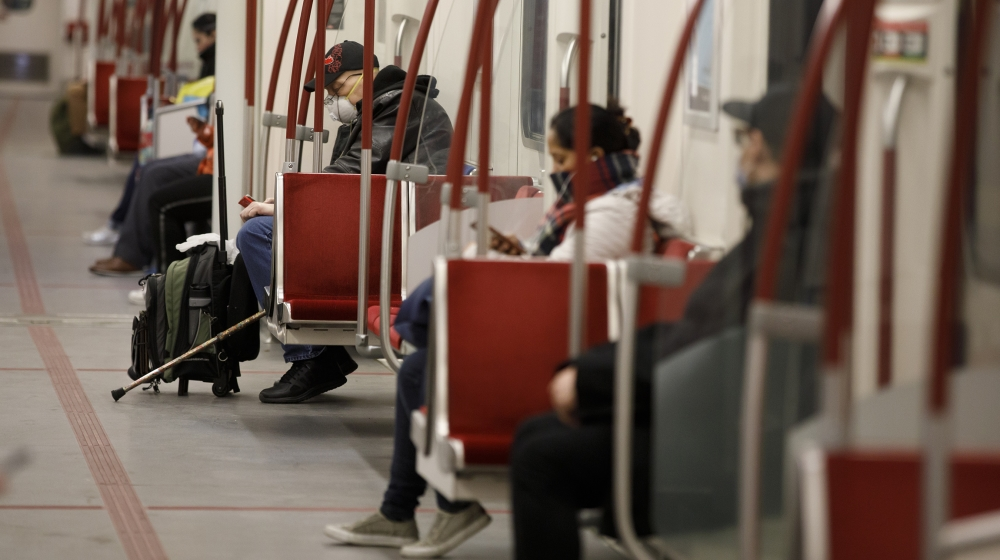 A man is seen wearing a mask in the subway during morning commuting hours as Toronto copes with a shutdown due to the Coronavirus, on April 1, 2020 in Toronto, Canada. Prime Minister Justin Trudeau sa