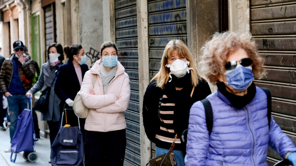 Customers queue at the Rialto fish market, as new restrictions for open-air markets are implemented by the Veneto region to prevent the spread of the coronavirus disease (COVID-19), in Venice, Italy,
