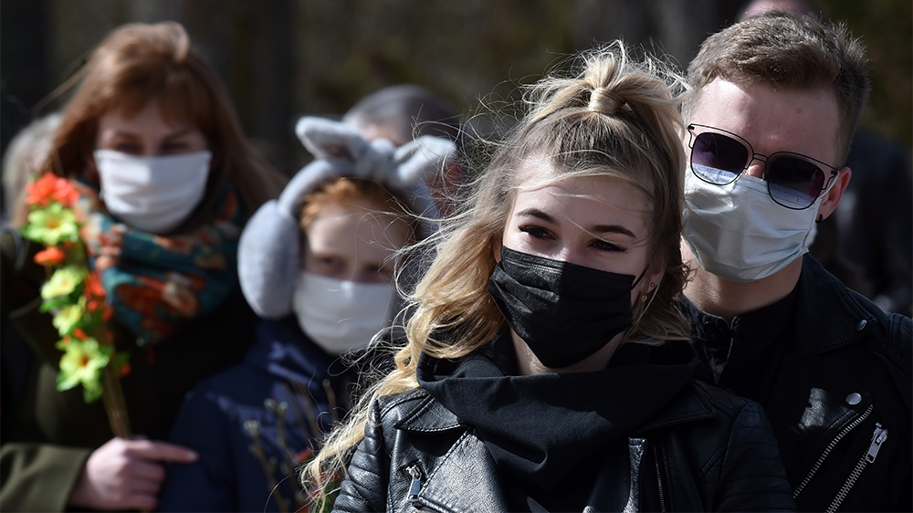 Catholic Christian believers wearing nose and mouth face masks, amid concerns over the spread of the COVID-19, the novel coronavirus, attend the Sunday service on April 5, 2020, in the town of Achmian