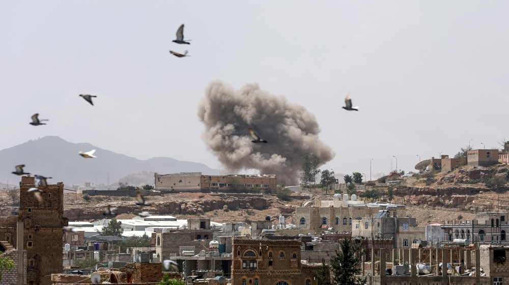 Dust rises from the site of a Saudi-led air strike in Sanaa, Yemen March 30, 2020. REUTERS/Khaled Abdullah