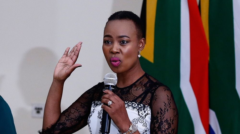 Newly appointed Minister of Communications and Telecommunications Stella Ndabeni-Abrahams (R) is sworn in by Chief Justice Mogoeng Mogoeng at Sefako Makgato Presidential Guesthouse on May 30, 2019 in