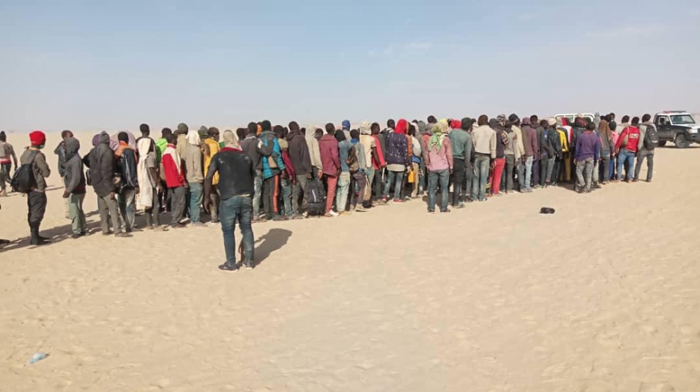 Migrants receiving assistance in Madama, a military outpost close to the border between Niger and Libya [ Courtesy: IOM Niger]