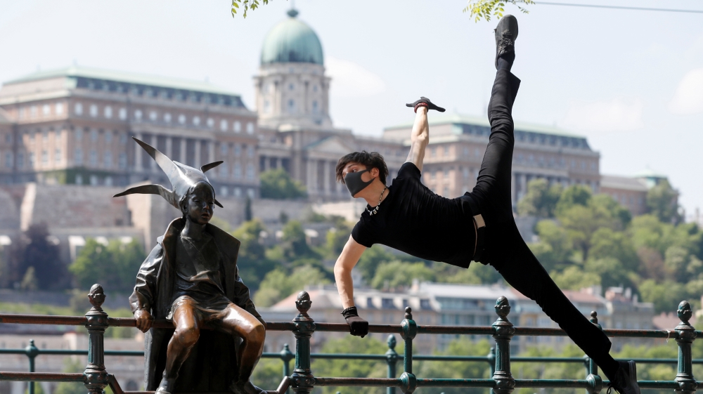 Hungarian ballet dancer Kovacs performs a choreographic piece he has designed for the 'coronavirus melody' during the coronavirus disease (COVID-19) outbreak in Budapest