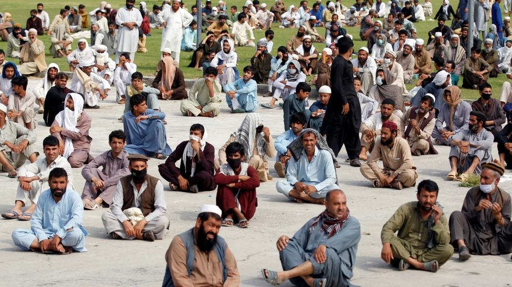 Food Men wait to receive free food amid coronavirus in Jalalabad, Afghanistan