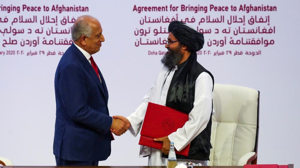 Taliban leader Mullah Abdul Ghani Baradar and Zalmay Khalilzad, U.S. envoy Afghanistan