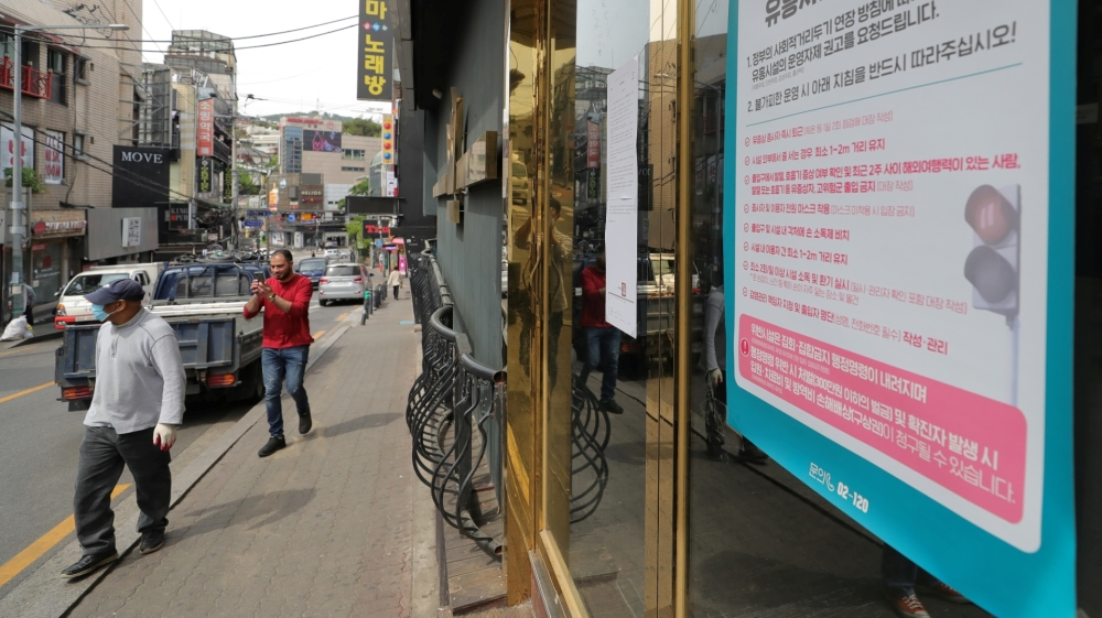 A list of precautions to prevent the spread of the coronavirus disease (COVID-19) is seen at an entrance of a club in Seoul