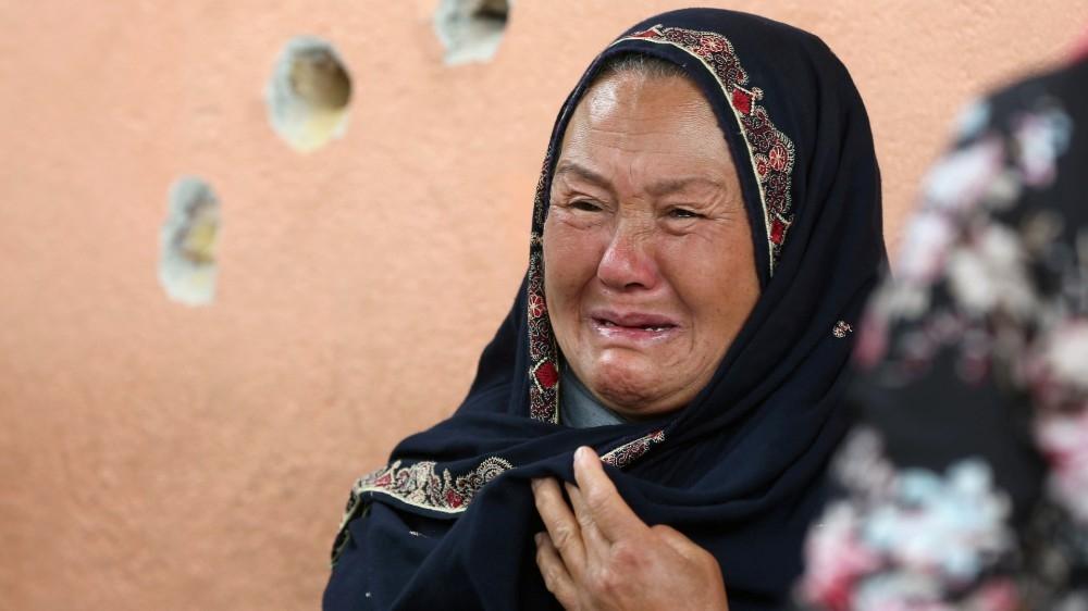 An Afghan woman cries
