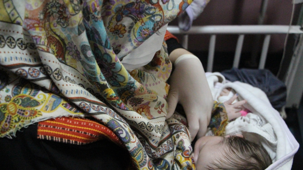 Newborn infants receive medical care in Kabul