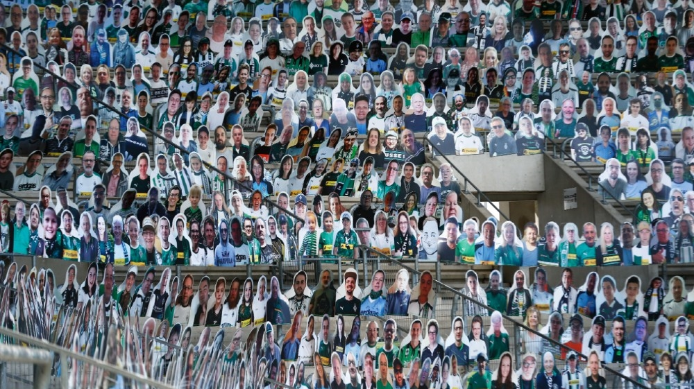 Life-size cardboard figures with the photos of football fans are positioned on the stands of the Borussia Moenchengladbach soccer stadium for the next game, which will be played withou