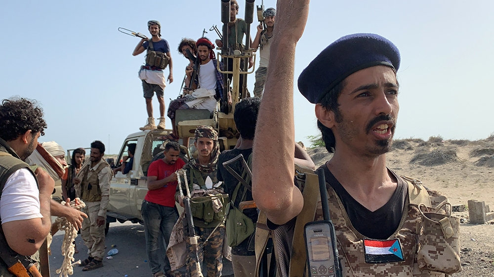 Fighters loyal to Yemen's Southern Transitional Council (STC) separatists gather at the frontline during clashes with pro-government forces for control of Zinjibar, the capital of the southern Abyan