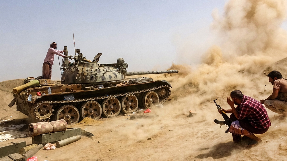 A tank belonging to forces loyal to Yemen's Southern Transitional Council (STC) separatists fires while on the frontline of clashes with pro-government forces for control of Zinjibar, the capital of t