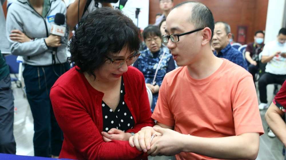 Parents in China find son abducted outside hotel 32 years ago
