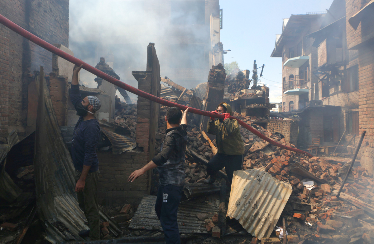 "The region's police chief, Dilbagh Singh, said it was ""a clean operation"", denying Indian forces were behind the arson or looting. ""This was a clean operation, and we were careful that it is a congested area and fire might spread. So, we had kept arrangements like ambulance and other things were there,"" Singh said. [Farooq Khan/EPA]"