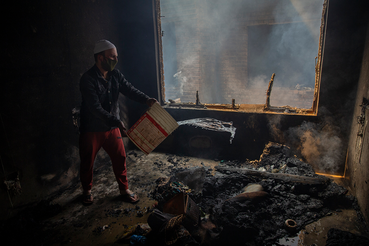 """We don't even have clothes to wear. We could not even take our mobile phones along. They also burned in our homes. We have no documents like identity cards, everything has ended,"" Afroza told Al Jazeera. [Dar Yasin/AP Photo]"
