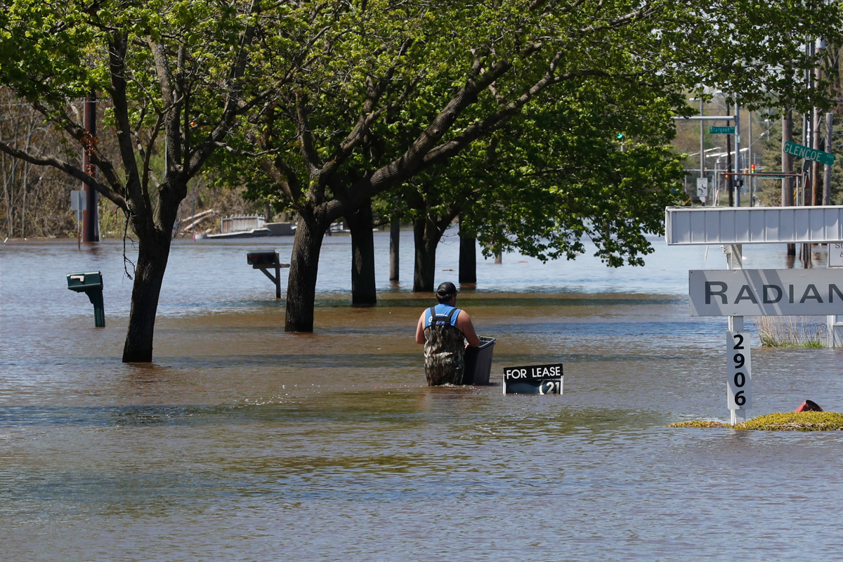 People living along two mid-Michigan lakes and parts of a river have been evacuated following several days of heavy rain that produced flooding and put pressure on dams in the area. [Carlos Osorio/AP Photo]