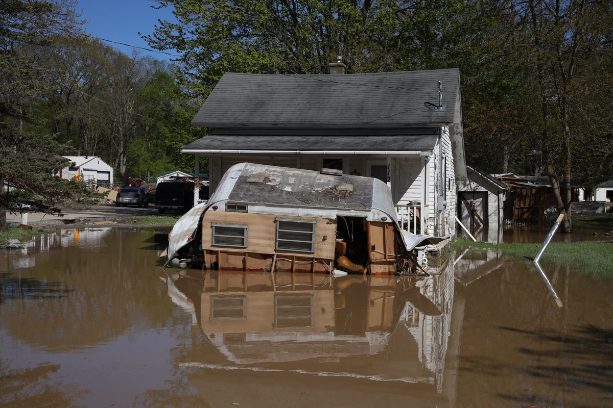 The flooding disaster and the evacuation are being compounded by the coronavirus pandemic, which has forced people to observe social distancing. [Gregory Shamus/Getty Images/AFP]