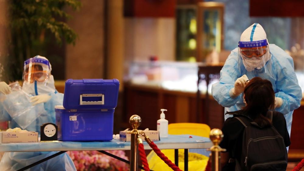 China drops 2020 economic growth target: Coronavirus live updates