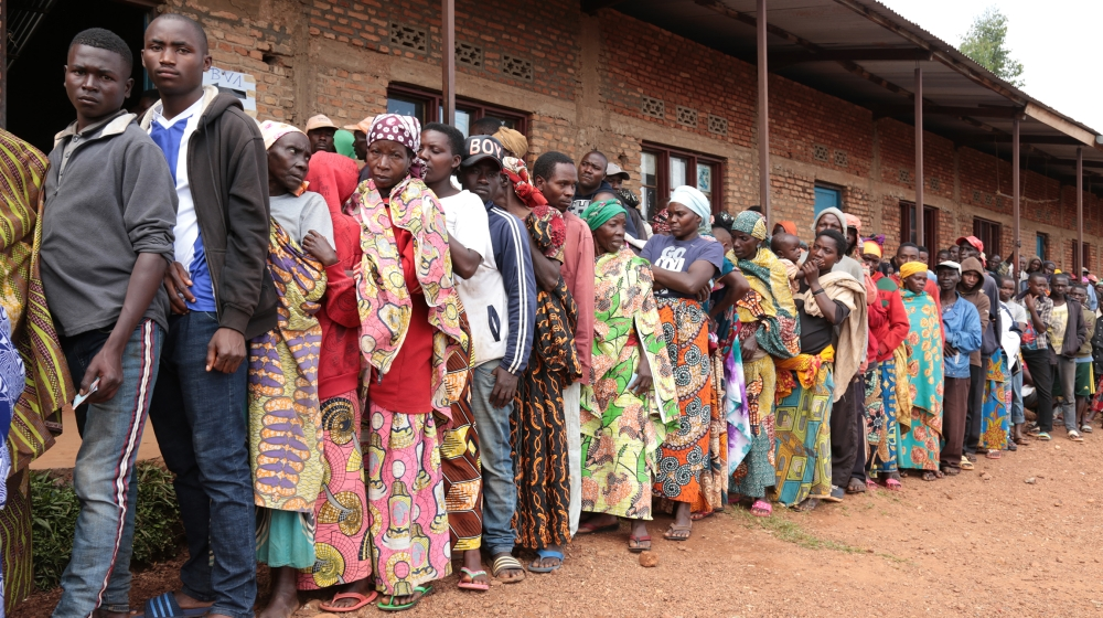 Burundians wait in a line to vote during the presidential and general elections at a polling station at the Bubu Primary school in Giheta, central Burundi, on May 20, 2020. The United States said TMay