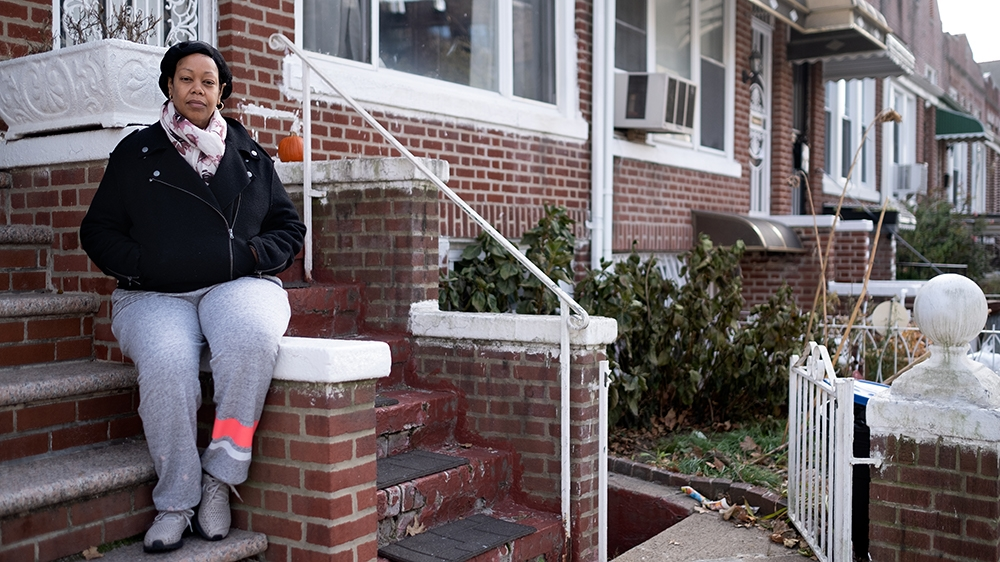 Still Here - Leah front stoop [Sara Bennett/Al Jazeera]