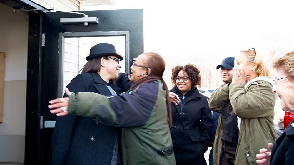 Still Here - Claude walking out the prison door [Sara Bennett/Al Jazeera]