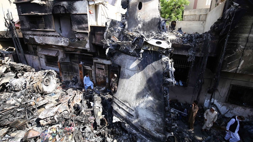 Wreckage of state run Pakistan International Airlines, Airbus A320 is lying amid houses of a residential colony days after it crashed, in Karachi, Pakistan, 24 May 2020. The death toll in a plane cras
